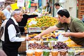 Jerusalem, Israel - November 15, 2012: People are shopping at Mahane Yehuda - famous market in Jerus