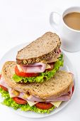 Ham, Lettuce , Cheese and Tomato big Sandwiches with Mustard  on Wholewheat Bread