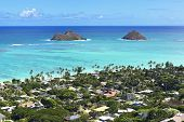 stock photo of off-shore  - mokulua islands off the shore of Lanikai Beach - JPG