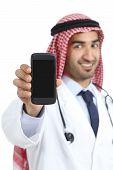 Arab Saudi Doctor Man Displaying A Smart Phone Application