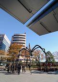 Tokyo, Japan - November 23, 2013: People Visit The Spider Sculpture Outside In Roppongi Hills