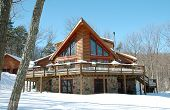 stock photo of log cabin  - Shot of the front of a log home - JPG