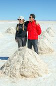 Couple of tourists in Salar de Uyuni, Bolivia