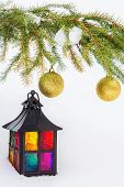 Decorative Lantern In The Snow And Fur-tree Branch With Christmas Balls