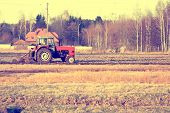 pic of plowing  - view of the old tractor plowing the field