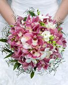 stock photo of marriage ceremony  - Wedding bouquet. Bouquet of fresh flowers for the wedding ceremony. Bouquet of orchids, roses and other flowers in the bride