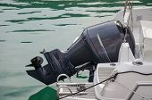 stock photo of outboard  - Outboard black motor on the white yacht - JPG