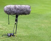 A Large Microphone Boom With Windshield
