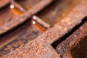 foto of manhole  - Close up of the rusty metal manhole cover with water. Metal texture.