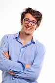Successful young student portrait wearing fashion eyeglasses.Happy young man portrait.