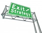 Exit Strategy words on a greed freeway, highway or road sign giving you directions to a way out