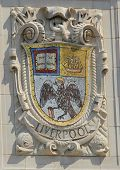 Mosaic shield of renowned port city Liverpool at the facade of United States Lines