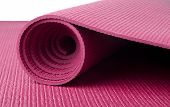 pic of yoga mat  - A pink yoga mat rolled up on white - JPG
