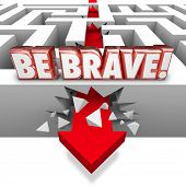 Be Brave word in red 3d letters over arrow crashing through maze wall illustrating confidence, coura