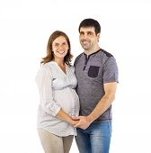 Pregnant couple in studio