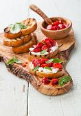 Italian Bruschetta With Chopped Strawberry, Basil And Goat Cheese On Grilled Crusty Bread