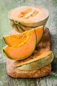 Cantaloupe Melon Slices On Olive Wood Cutting Board