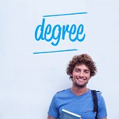 The word degree against happy student holding book