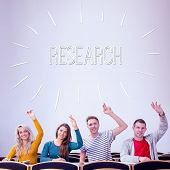 The word research against college students raising hands in the classroom