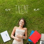 The word talent against pretty student lying on grass