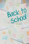Back to school message against white paper strewn over grid
