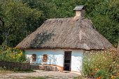 Old House With A Thatched Roof In The Village.