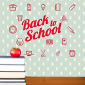 Back to school message with icons against red apple on pile of books