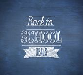 Composite image of back to school deals message against blue chalkboard