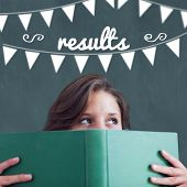 The word results and bunting against student holding book