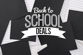 Back to school deals message against black paper strewn over notepad