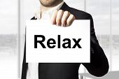 Businessman Holding Sign Relax