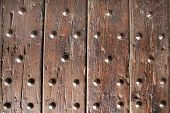 Texture of ancient wood with rivets