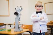 Cute pupil dressed up as scientist in classroom at the elementary school