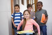 stock photo of disable  - Disabled pupil with his friends in classroom at the elementary school - JPG