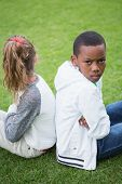 Young friends not talking to each other after fight in the park