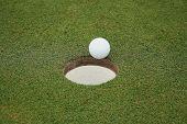 Golf ball enters hole