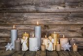 stock photo of christmas angel  - Christmas decoration with candles and golden angels on wooden background - JPG