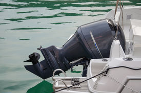image of outboard  - Outboard black motor on the white yacht - JPG