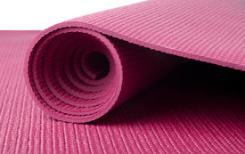stock photo of yoga mat  - A pink yoga mat rolled up on white - JPG