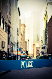 image of safety barrier  - Retro Style Photo Of A Poice Barrier At A Crime Scene In A City Street - JPG