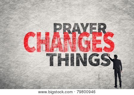 Asian businessman write text on wall, Prayer Changes Things