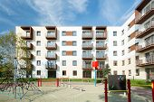 picture of public housing  - Public square for children in front in housing development - JPG