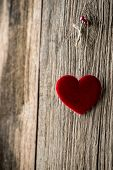 foto of soulmate  - Red heart hanging on wooden texture background - JPG