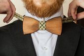 Fragment of suit. Wooden bow tie.