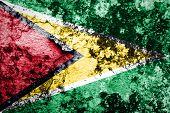 Guyana Flag painted on grunge wall