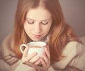 Happy Girl Is   Under A Blanket And  Cup Of Coffee On Winter Morning At Home