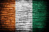 Ivory Coast Flag on old wood texture. .
