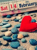 stock photo of sweetheart  - Red heart symbol of love with desk calendar Feb 14 on it nice pebble fiber background with vintage color Valentine day is special day for lover with sweetheart - JPG