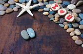 picture of love hurts  - Colourful harmony Valentine background amazing style heart on pebble I love you message on stone wooden red color Valentine day on Feb 14 is the day for couple they give lovely gift for lover - JPG