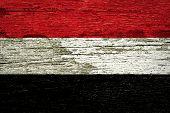 Yemen Flag painted on old wood.